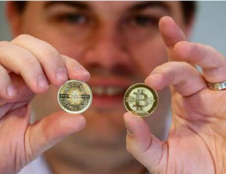 Bitcoin value reaches all-time high at $10,000