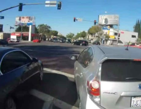 Watch this angry BMW driver ram into a motorcyclist when asked to stop texting [video]