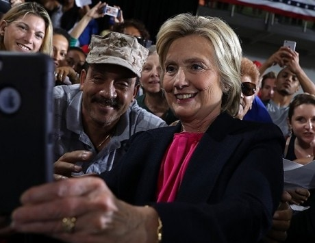 Dawn of the age of the selfies: Crowd turns back on Hillary Clinton to take photos
