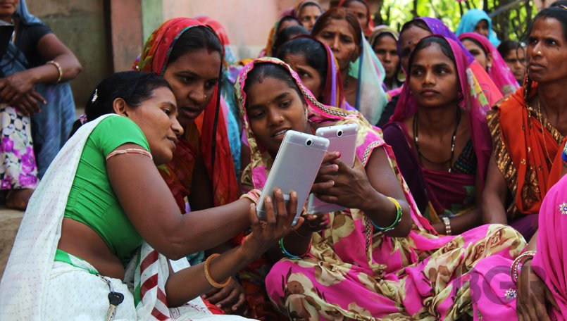 Beautiful Indian women with tablet