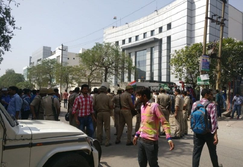 Protests, FIR against Oppo official who tore Indian flag