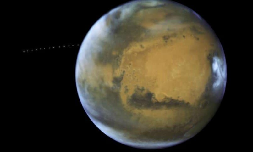 NASA's Hubble captures Mars' tiny moon Phobos photobombing the Red Planet!