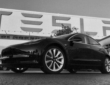 Tesla again halts Model 3 production