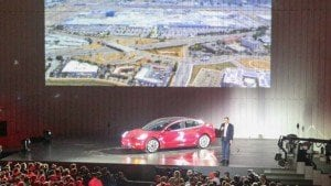 Tesla Model 3 electric car makes commercial debut as Elon Musk hands it to 30 buyers