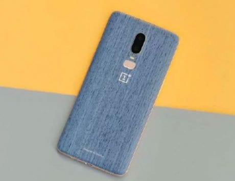 OnePlus 6 in Wood and Canvas Blue color shown by designer
